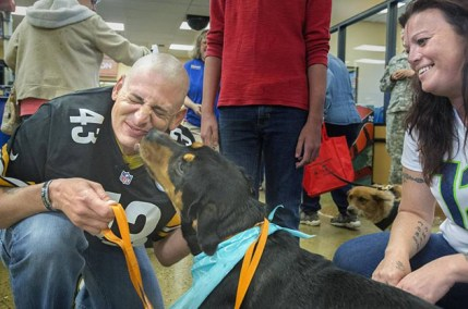 Zeus is reunited with his family after almost 3 years. Photo from Tacoma News Tribune.