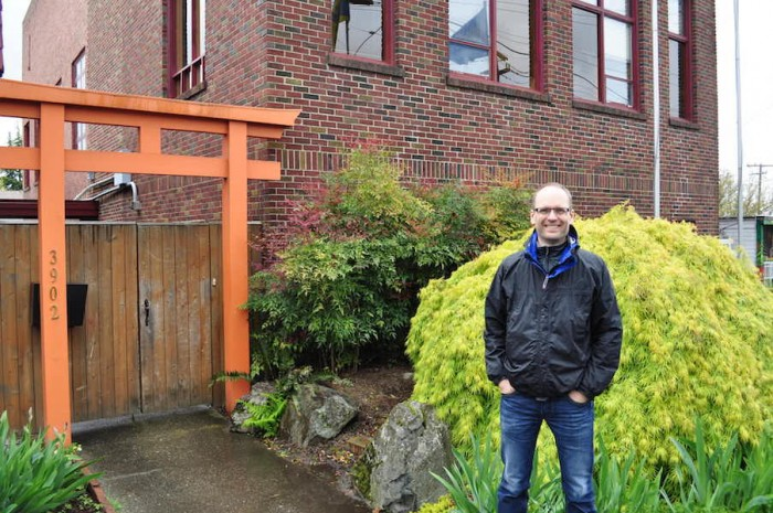 Erik Koto standing outside a buddhist temple in Fremont. (Photo by Danish Mehboob)