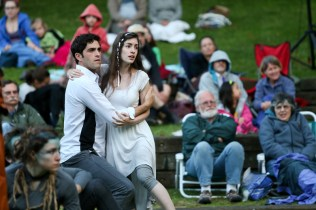 """Jonathan Crimeni as Ferdinand and Anastasia Higham as Miranda in Seattle Shakespeare Company's 2013 Wooden O production of """"The Tempest."""""""