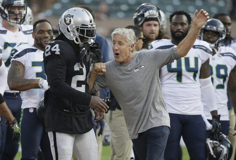 Seahawks Pete Carroll' with Raiders' Marshawn Lynch