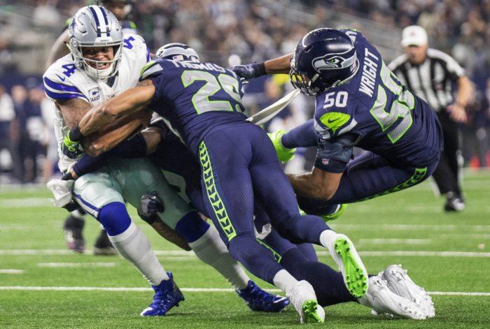 K.J. Wright and Earl Thomas put the hurt on Cowboys QB Dak Prescott (Dean Rutz / The Seattle Times)