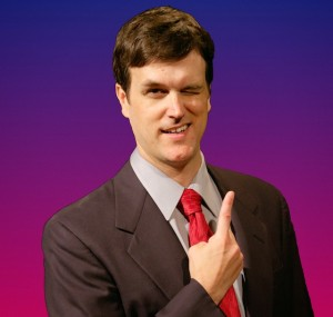 Brandon Felker is game show host Troy Richards in Theater Schmeater's production of GAME SHOW.