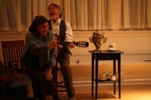"The ever-present Marina (Zhenya Lavy) and unfortunate Ilya Illich (Sean Patrick Taylor) stir it up with a rousing ""Когда мы были на войне""  Photo by Annie Paladino."