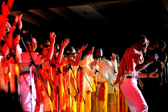 "Eusebe Jaojoby, considered the king of salegy, performs with the ""TANA GOSPEL CHOIR"" in 2009. Photo by carlos.Licensed CC-BY-NC-ND."