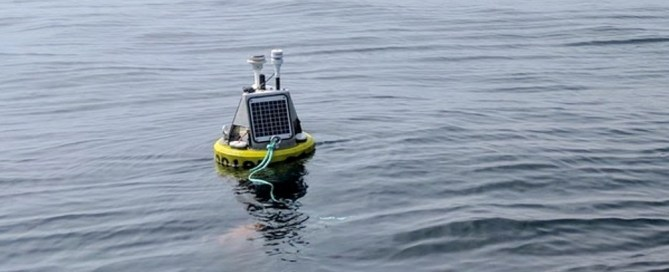 A buoy featuring the SeaView Systems SVS-603 wave sensor is shown deployed near Stannard Rock LIghthouse in Lake Superior.