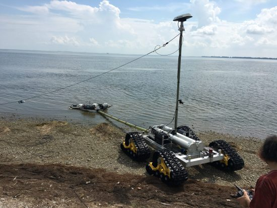 The SeaView Systems SurfROVer robotic remote operated vehicle is shown towing a sensor array in the littoral surf zone.