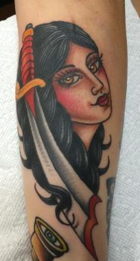 pretty lady with a sharp dagger, jason walstrom tattoos, lady tattoo, minneapolis tattoo, minnesota tattoo, traditional tattoo, traditional tattoos