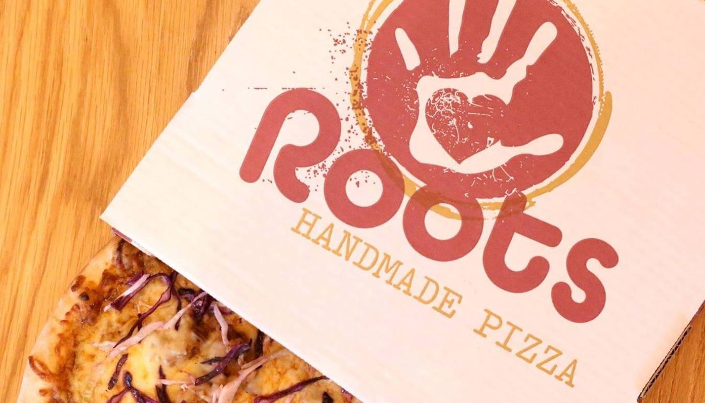 Roots Handmade Pizza is Now Open at Piper's Alley