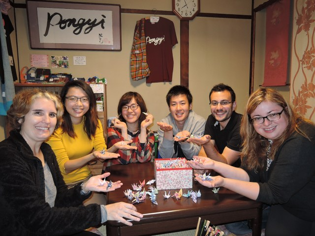 Creating origami cranes for a peace project at Pongyi Guesthouse, Kanazawa in November