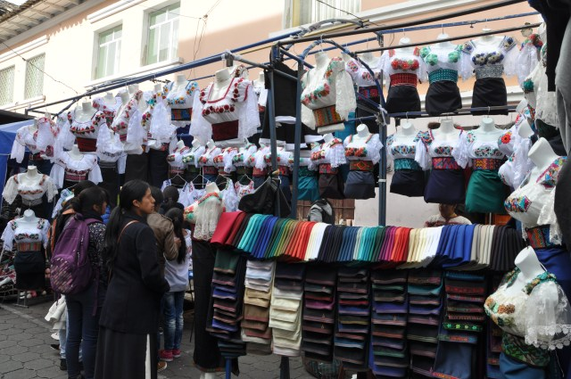 Buying traditional indigenous dress, Otavalo market