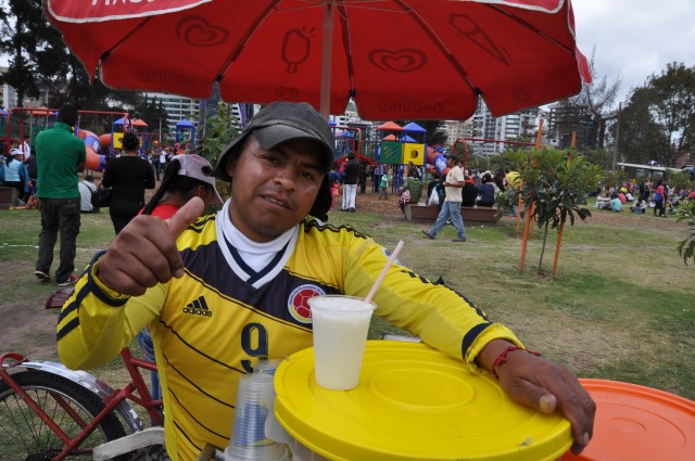 Colombian refugee selling delicious agua de coco, Parque la Carolina
