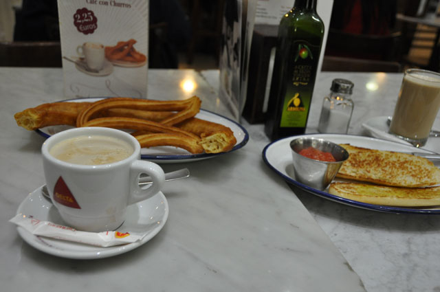 My kind Airbnb host in Madrid took me out for a typical Spanish breakfast: churros, café con leche, and pan con tomate