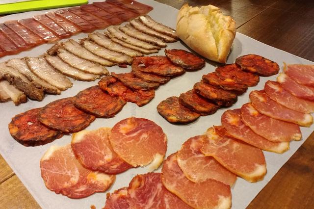 Trying delicious tapas on Devour Spain's Tapas & Wine Tasting Tour