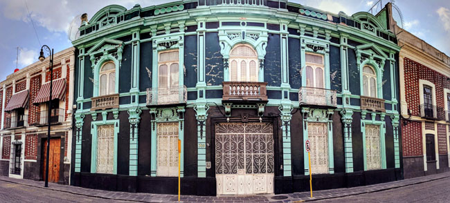 The streets of Puebla, Mexico are filled with gorgeous houses like this.