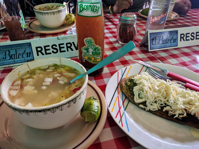 Trying pozole and a tlacoyo at a local restaurant for lunch with Livit