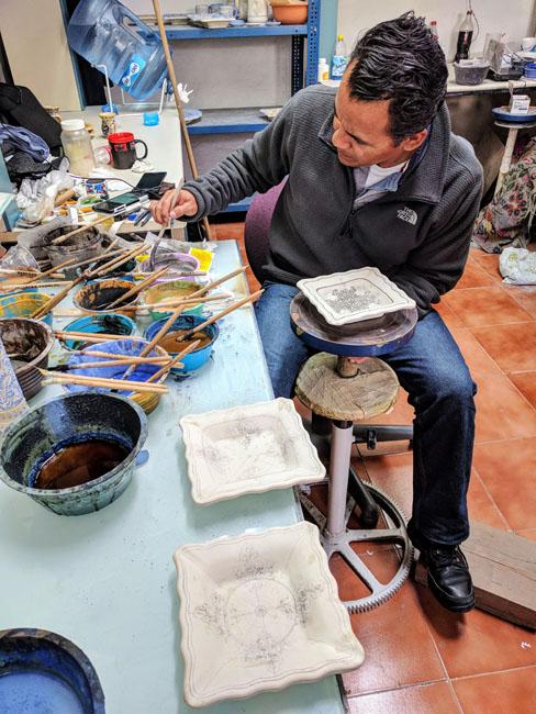 Visiting a talavera ceramic workshop with the guide, Puebla