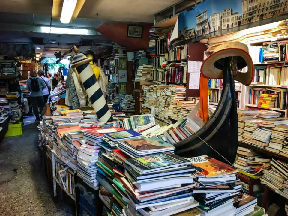 Libreria Acqua Alta gondola – Venice, Italy - top bookstores in the world