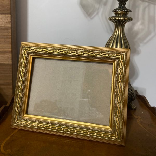 Front view of Ornate Gold Frame.