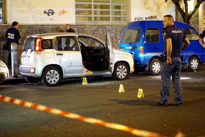 L'auto civetta della Polizia, una Fiat Panda, crivellata di colpi. (Ansa/Fusco)