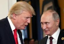 Vladimir Putin con Donald Trump in una foto d'archivio