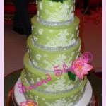 5 tiers wedding cake in light green with pink lotus with henna design piping from Second Slices® cake shop eggless bakery in Edmonton AB