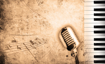 Piano keyboard, microphone and music