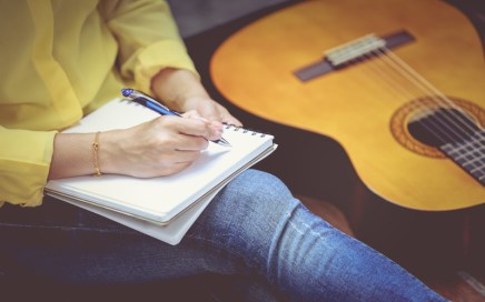 Songwriter with guitar