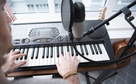 Songwriter working at a keyboard