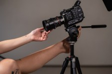 hands reaching towards a movie camera