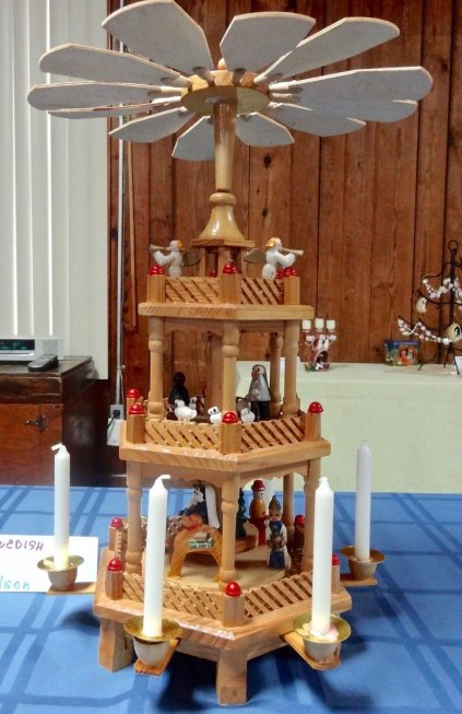 This intricate multilayered nativity made in Sweden moves when the candles are lit to produce the draft that powers the windmill. It is owned by Judith & Ed Olson.