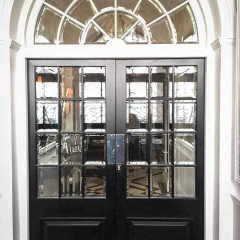 Steel security doors with bevelled glass