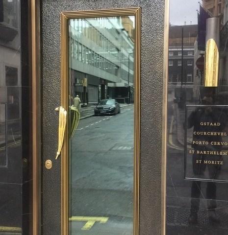 Liquid metal finish on a security door