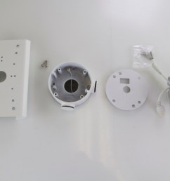 from left to right pole mount bracket screws that come in pole mount bracket box hornet mount foam padding from mounting box and the camera [ 1123 x 749 Pixel ]