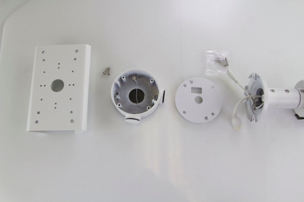 medium resolution of from left to right pole mount bracket screws that come in pole mount bracket box hornet mount foam padding from mounting box and the camera