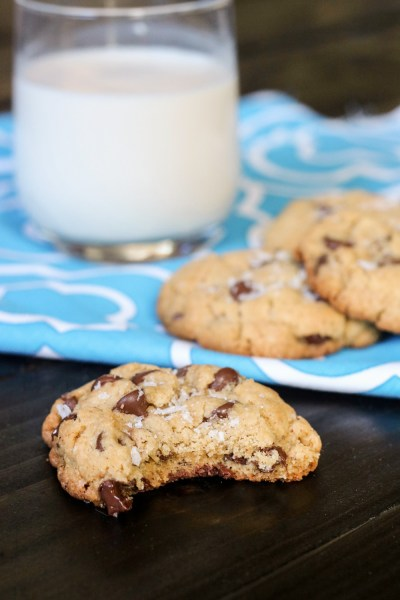 Chocolate chip cookie sprinkled with salt and a glass of milk
