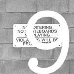 "#9 sign on wall reading, ""NO LOITERING"""