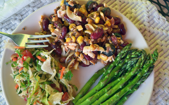 plate of Mexican Pasta Salad served with cole slaw and asparagus