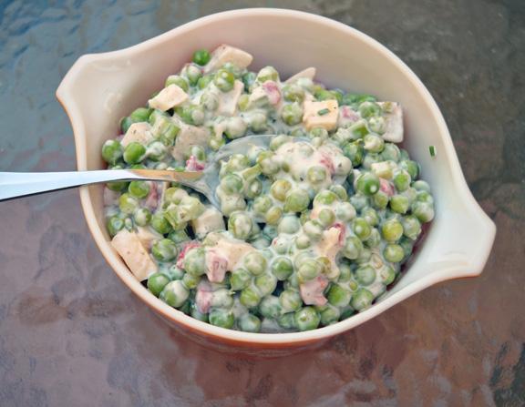 bowl of prepared pea salad.