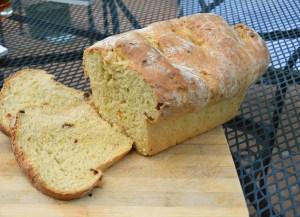 sliced loaf of zucchini tomato bread