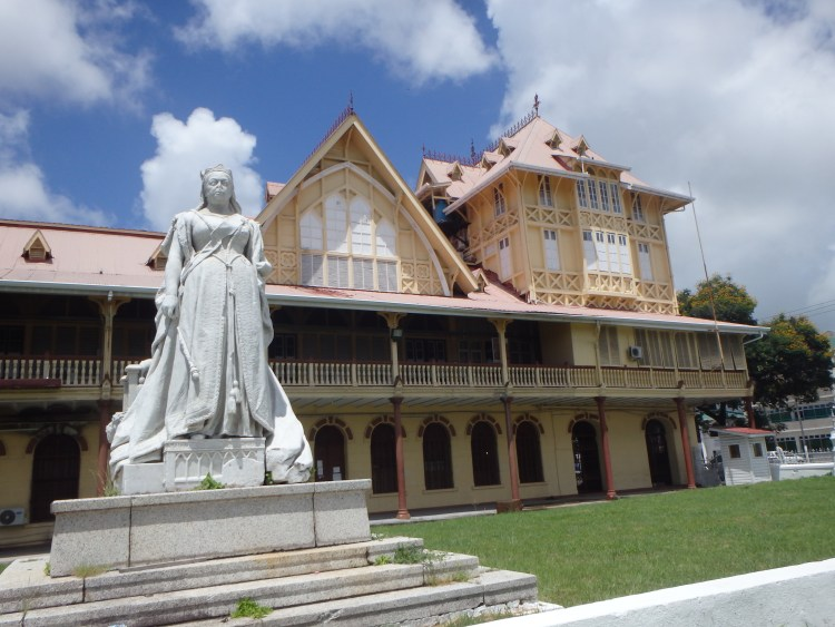 Guyana High Court with Queen Victoria statue where to visit in Guyana hotels