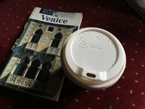 Venetian reading and breakfast in 'bed' in our train couchette (sadly, with disposables coffee cup).
