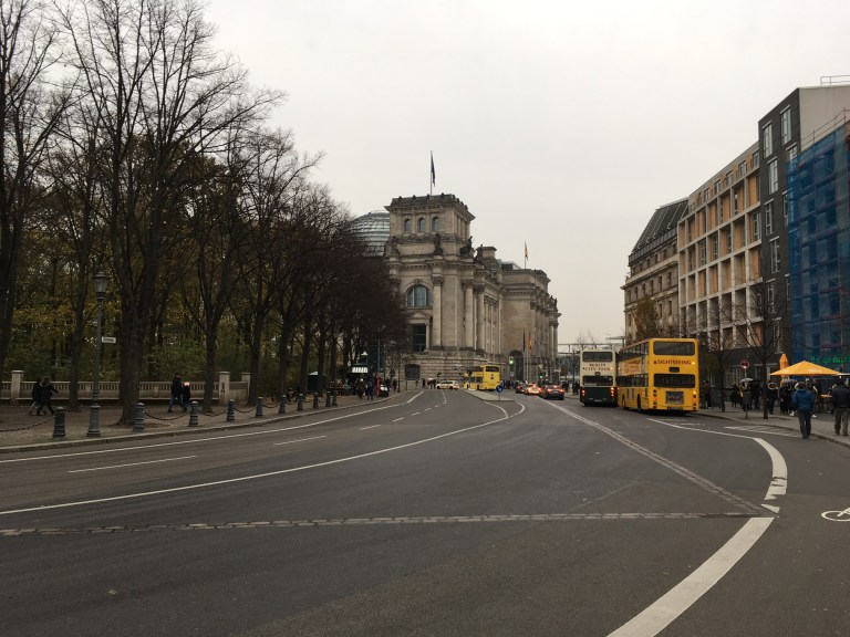 Cobblestones mark where the Berlin Wall cut between the Reichstag and the Brandenburg Gate.