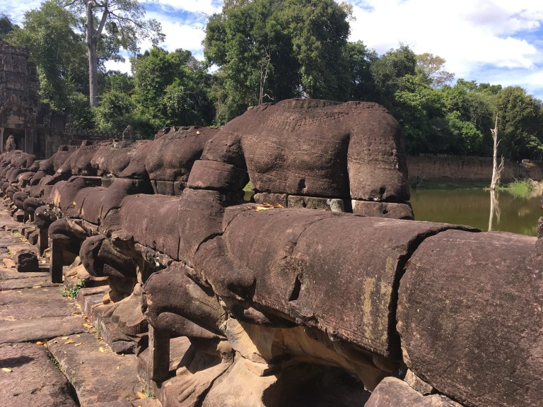 Beheaded by thieves these asuras guard the bridge to Preah Khan.
