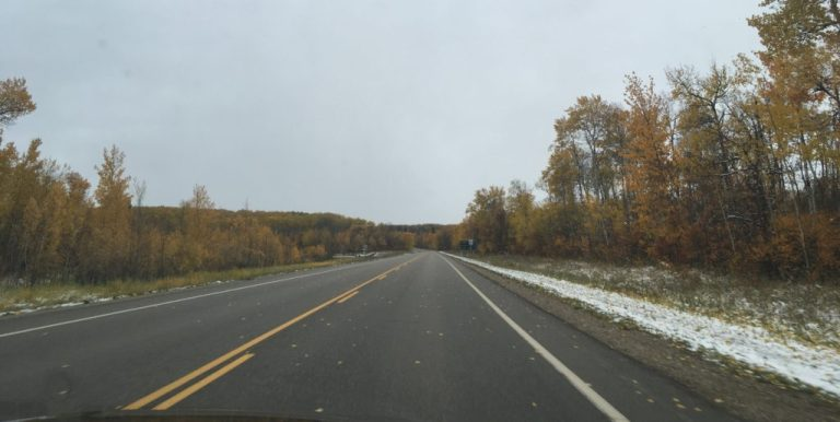 Snow begins to arrive en route to our wedding venue in Wasagaming, Riding Mountain National Park.