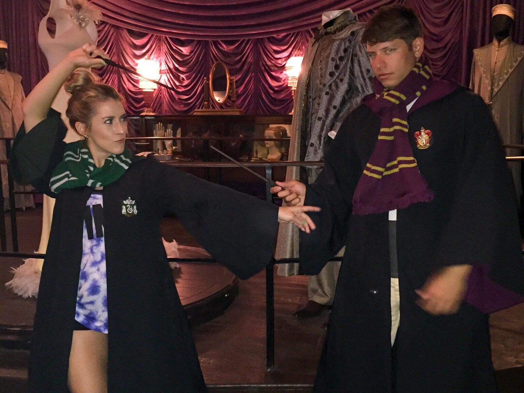 Wand battle between Slytherin and Gryffindor students at Madam Malkin's Robes for all Ocassions