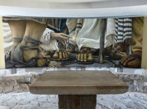 Encounter Chapel mural, by Chilean artist Daniel Cariola, depicts the woman who sought healing by touching the hem of Jesus' cloak in Mark 5:25-34 (Seetheholyland.net)