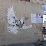 Peace symbol among graffitti on separation wall in Bethlehem (Seetheholyland.net)