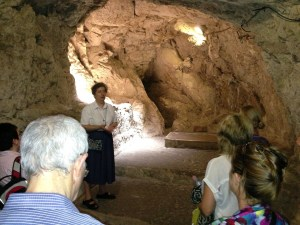 Sr Stefania talking to visitors in the cave church (© Gregory Jenks)