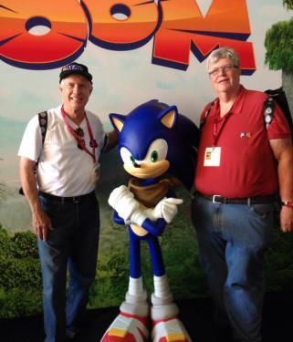 Tom Kalinske and Al Nilsen pose with Sonic the Hedgehog.