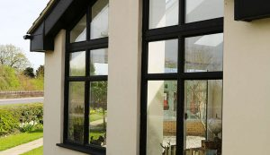 Tall black aluminium casement windows installation